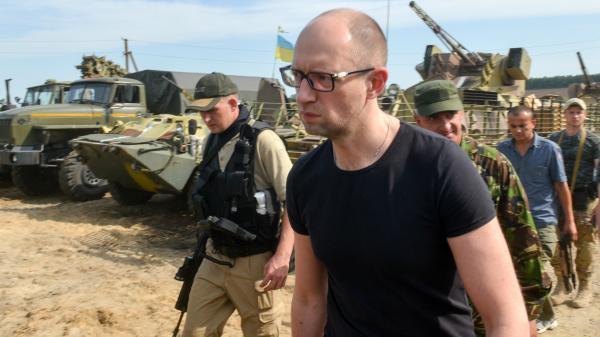Ukrainian Prime Minister Arseniy Yatsenyuk visits forces stationed near the small city of Izyum on Wednesday.