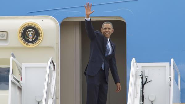 President Obama waves before boarding Air Force One prior to his departure from Andrews Air Force Base on June 26.