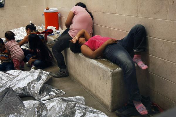 Immigrants who have been caught crossing the border illegally are housed inside the McAllen Border Patrol Station in McAllen, Texas where they are processed on July 15, 2014 in McAllen, Texas. (Rick Loomis/Getty Images)