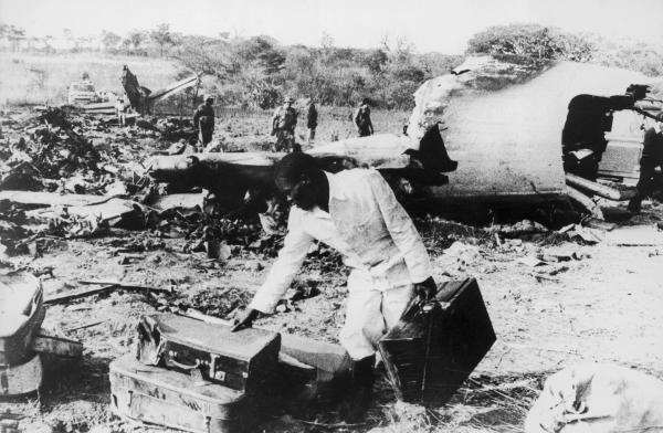 Men sift through the wreckage of an Air Rhodesia plane shot down by guerrilla fighters in September 1978 in northern Rhodesia (now Zimbabwe). The rebels shot down another Air Rhodesia flight five months later.