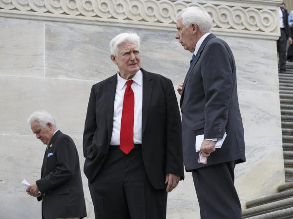 Retiring Virginia Reps. Jim Moran (center) and Frank Wolf talk as congressmen leave the House of Representatives in April. Moran's name appears on on a Russian visa blacklist issued on Saturday.