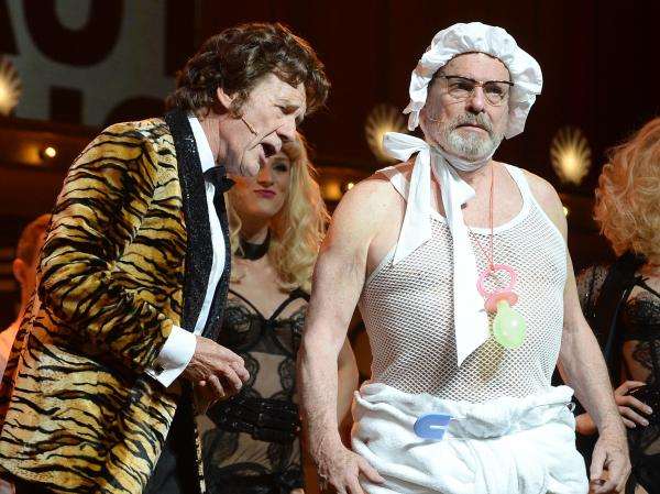Michael Palin, left, and Terry Gilliam perform on the opening night of <em>Monty Python Live (Mostly)</em>. The final performance of the reunion show, on Sunday, will be live-streamed at theaters around the world.