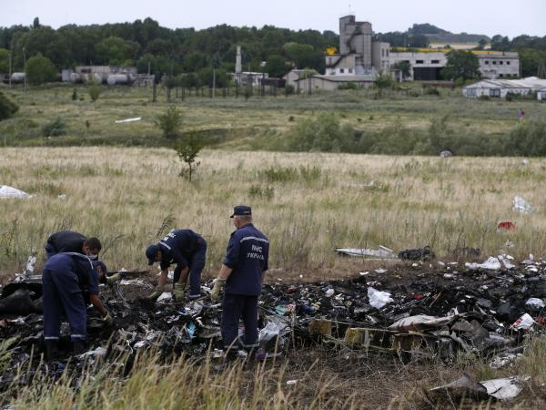 Members of the Ukrainian Emergencies Ministry work at a crash site of Malaysia Airlines Flight MH17, near the village of Hrabove, Donetsk, on Sunday.