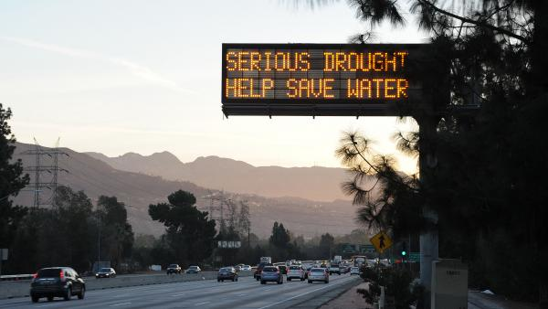 A sign over a highway in Glendale, Calif., warned motorists in February to save water in response to the state's severe drought. But a study released earlier this week showed residents in the southern coastal part of the state used <em>more </em>water this spring than they did last year.