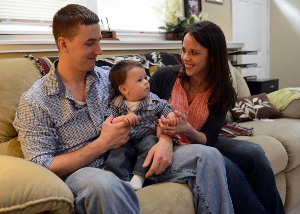 Ryan Pitts and his wife Amy share a moment with their son Lucas, at their home in New Hampshire, May 3, 2014. (U.S. Army)