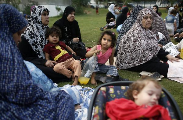 Palestinians who have fled their homes of due to the fighting in the Gaza Strip gather on the grounds of Shifa Hospital on Sunday. In many cases, no members of the families were wounded, but they felt the hospital was the only safe place to be.