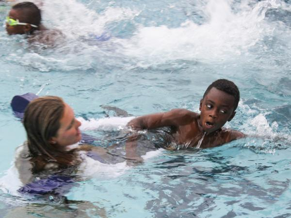 Gary Kendrick, 8, works on his freestyle stroke with help from a counselor at Ransom Everglades School. Kendrick did not know how to swim before he started lessons at the school.