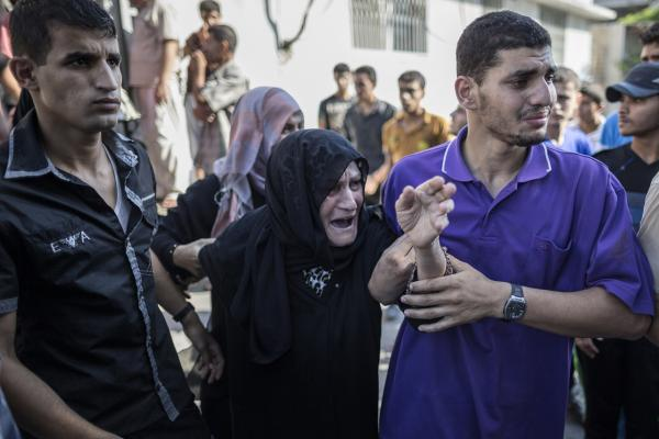 Relatives of Palestinians killed during the overnight shelling of the eastern Gaza district of Shejaiya by the Israeli army arrive at the morgue of the al-Shifa hospital on July 20, 2014 in Gaza City. (Marco Longari/AFP/Getty Images)