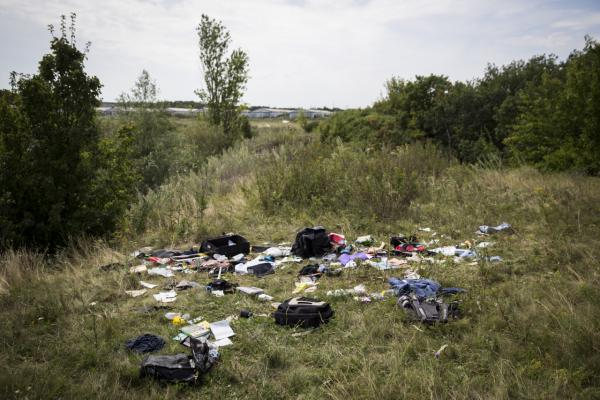 Luggage and personal belongings from Malaysia Airlines flight MH17 lie in a field on July 20, 2014 in Grabovo, Ukraine. Malaysia Airlines flight MH17 was travelling from Amsterdam to Kuala Lumpur when it crashed killing all 298 on board including 80 children. The aircraft was allegedly shot down by a missile and investigations continue over the perpetrators of the attack.  (Rob Stothard/Getty Images)