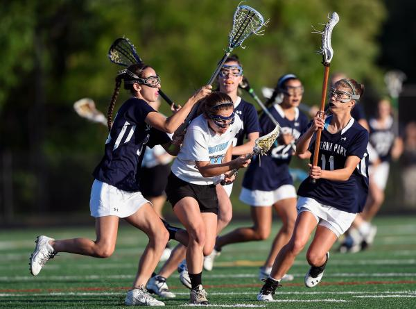 Walt Whitman High School's Caroline Schweitzer runs through a host of Severna Park High School defenders during a semifinal game in Maryland's Class 4A/3A lacrosse tournament in May.