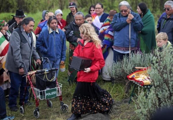 During a special ceremony, scientists and representatives of six tribes reburied a 12,600-year-old Clovis child in a patch of sagebrush on Saturday June, 28, 2014, close to the site where he was accidentally unearthed almost 50 years ago. (Shawn Raecke/Livingston Enterprise)