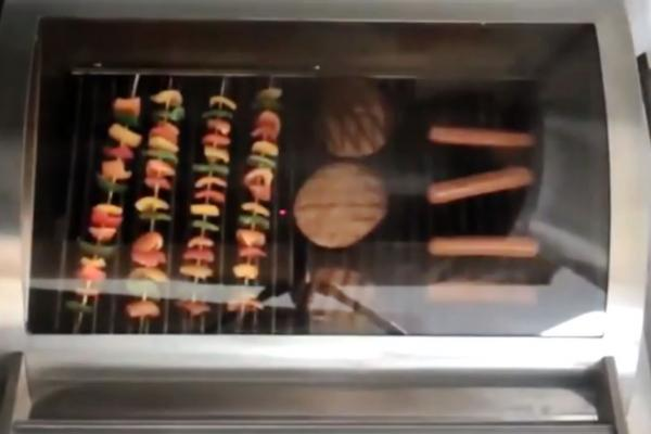 A still from a video showing a glass top grill.