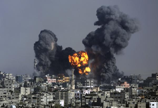 Smoke and fire rises over Gaza City on Tuesday. Israeli airstrikes pummeled a wide range of locations along the coastal area as diplomatic efforts intensified to end the two-week war.