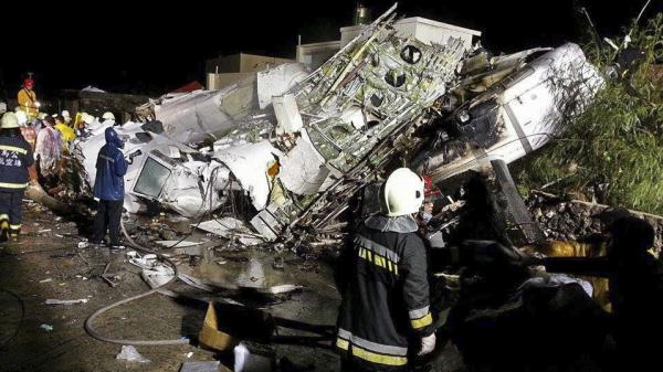 Rescue crews work on the wreckage of TransAsia Airways Flight GE222, which crashed while attempting to land in stormy weather on the Taiwanese island of Penghu, late Wednesday.