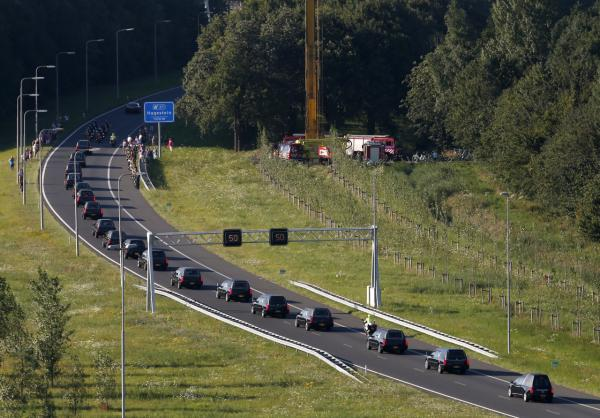 A convoy of funeral hearses carrying coffins containing the remains of victims of the downed Malaysia Airlines flight MH17, drives from the Eindhoven Airbase to Hilversum on July 23, 2014. (Jerry Lampen/AFP/Getty Images)