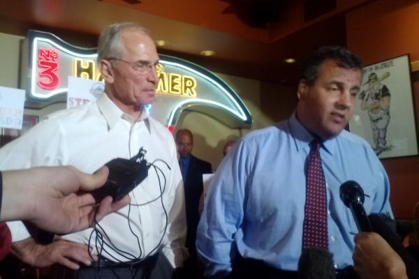 Republican Gubernatorial candidate Bob Beauprez talks to reporters with Chris Christie. Christie, the head of the Republican Governor's Association is in Colorado campaigning for Beauprez.