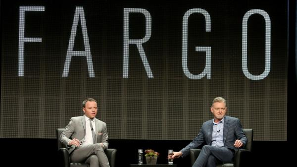 Noah Hawley (left) and Warren Littlefield, executive producers of the FX series <em>Farg</em>o, speak at the Television Critics Association's summer press tour.
