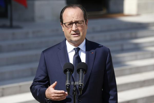 French President François Hollande speaks to the press at the Elysee Palace in Paris on Friday.