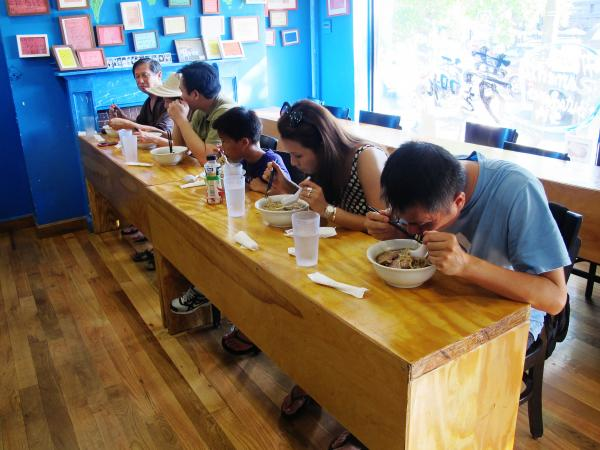 At this shop, finishing the huge, rich bowls of ramen requires fortitude and deep concentration.