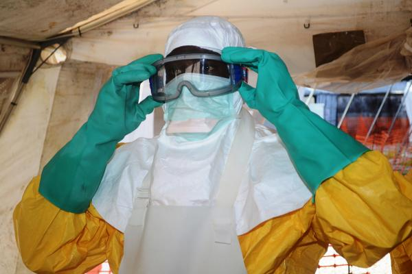 A picture taken on June 28 shows a member of Doctors Without Borders (MSF) putting on protective gear at the isolation ward of the Donka Hospital in Conakry, Guinea, where people infected with the Ebola virus are being treated. (Cellou Binani/AFP/Getty Images)