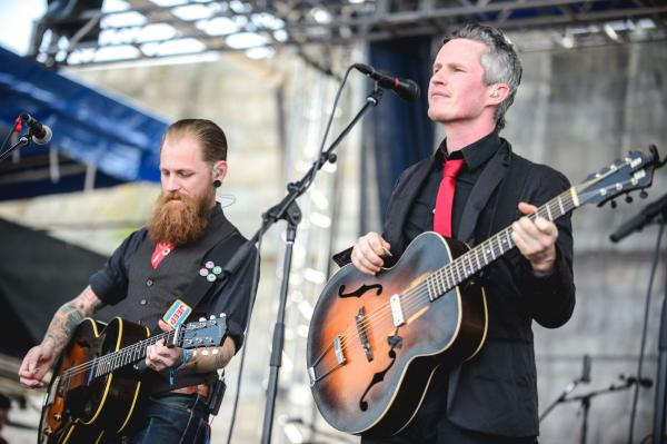 Pete Bernhard (right) and Cooper McBean of The Devil Makes Three perform at the 2014 Newport Folk Festival.