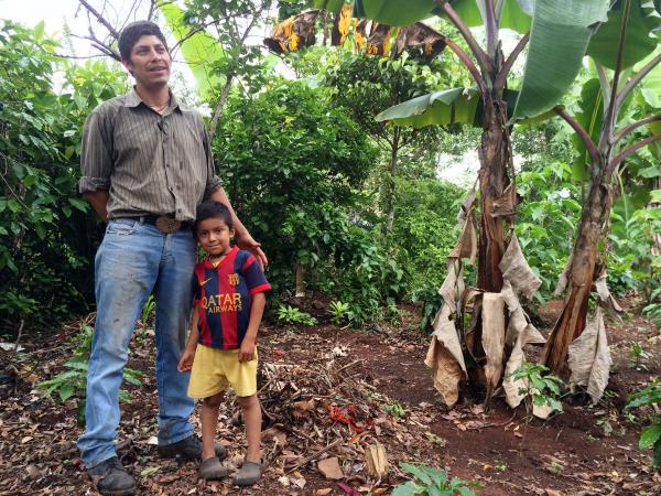Edwin Fernando Diaz Viera and his son at their small farm outside Olopa, Guatemala, near the Honduran border. Diaz's coffee crop was wiped out by the coffee rust fungus. He has since replanted with a new plant that's supposedly resistant to rust.