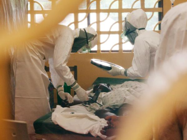 Medical workers treat Ebola patients at the Eternal Love Winning Africa hospital in Monrovia. Two workers at the hospital, including Brantly (left), have tested positive for Ebola.