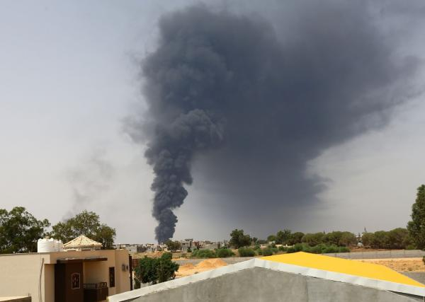 Smoke billows from an oil depot, July 28, 2014, where a huge blaze started following clashes around Tripoli airport, in southern Tripoli. (Mahmud Turkia/AFP/Getty Images)