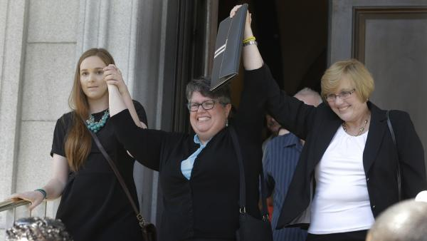 Plantiffs in the suit over Virginia's ban on gay marriage, Emily Schall-Townley (from left), Carol Schall and Mary Townley, after a hearing on May 13.