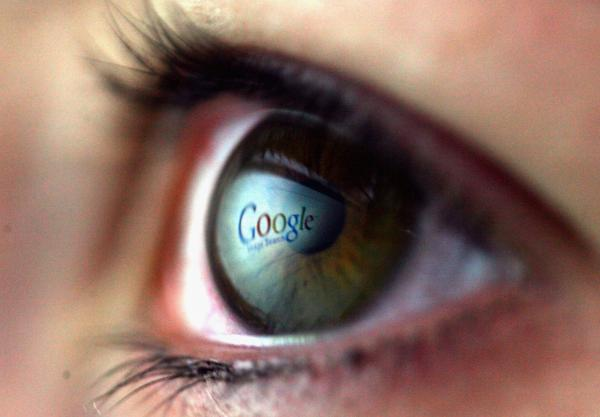 In this photo illustration, the Google logo is reflected in the eye of a girl on February 3, 2008 in London, England. (Chris Jackson/Getty Images)