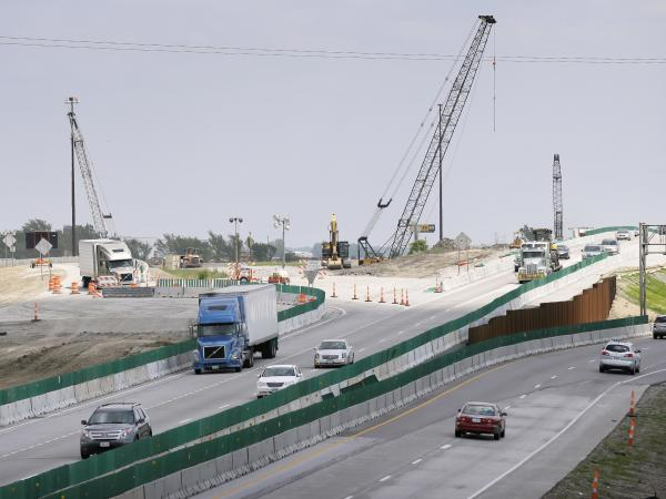 Traffic passes a construction zone at the interchange of U.S. Highway 65 and Interstate 80, in Altoona, Iowa
