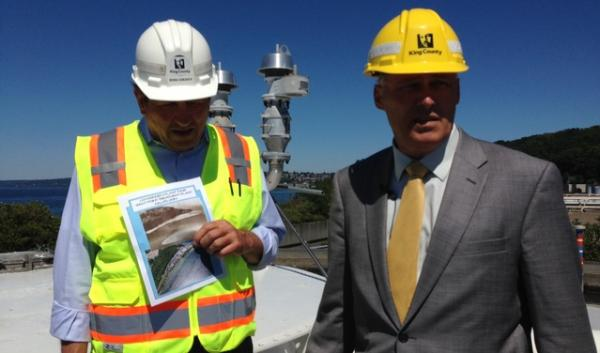 Dan Grenet (left), the manager of Seattle's West Point Wastewater Treatment Plant, leads Wash. Gov. Jay Inslee of a tour. The visit was intended to highlight the costs of climate change; in this case, as a result of seawater incursion at the facility.
