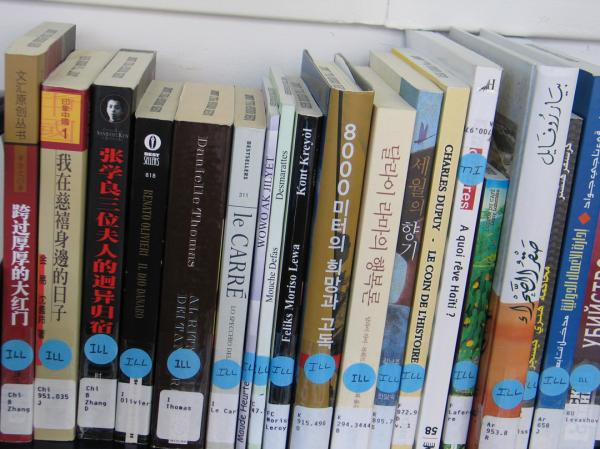 Several languages share space on library shelves.