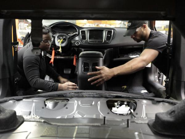 Assembly-line workers at the Chrysler plant in Sterling Heights, Mich. The economy is getting good marks in the latest data, but some worries about the job market continue.