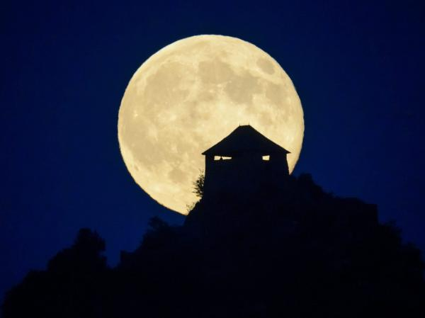 The full moon rises above the castle of Somoskoujfalu, northeast of Budapest, Hungary, earlier this month.