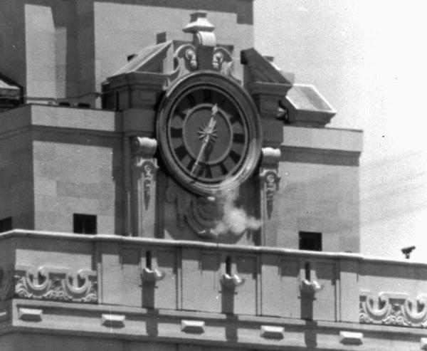 In this Aug. 1, 1966 photo, smoke rises from Charles Whitman's gun as he fires from the tower of the University of Texas administration building in Austin, Texas, at people below. The engineering student and former Marine killed 13 people and an unborn child and wounded 32 others in the shooting.  (AP)