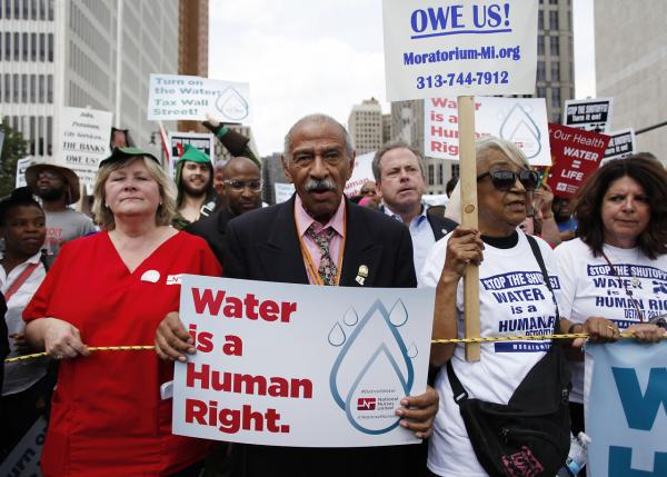 Congressman John Conyers, Jr., (D-Mich.) joins demonstrators protesting against the Detroit Water and Sewer Department July 18 in Detroit, Michigan. The Detroit Water and Sewer Department have disconnected water to thousands of Detroit residents who are delinquent with their bills.  (Joshua Lott/Getty Images)