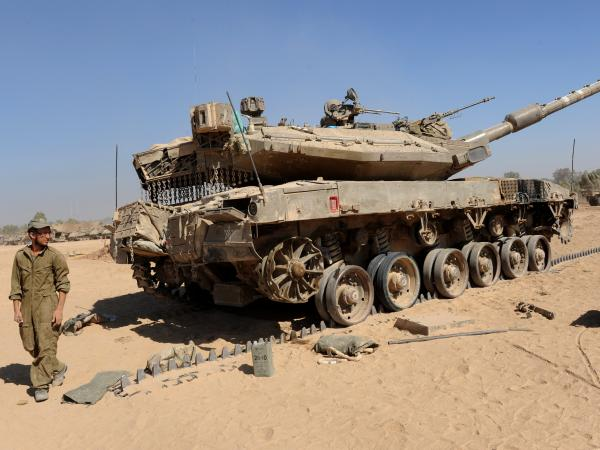 An Israeli Merkava tank near the Hamas-controlled Gaza Strip border in southern Israel, on Thursday. The Pentagon confirms that Israel tapped a U.S. weapons stockpile for tank rounds.