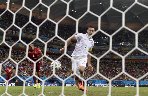 U.S. forward Clint Dempsey scores during a Group G football match between USA and Portugal at the Amazonia Arena in Manaus during the 2014 FIFA World Cup on June 22, 2014. (Odd Andersen/AFP/Getty Images)
