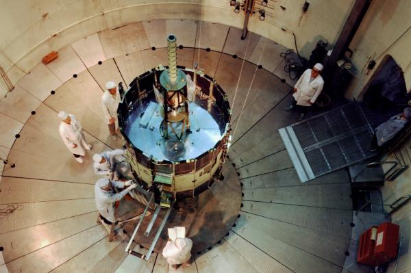 This 1976 photo shows the International Sun-Earth Explorer C (ISEE-3, ICE) undergoing testing in the Goddard Space Flight Center's dynamic test chamber. (Wikimedia Commons)