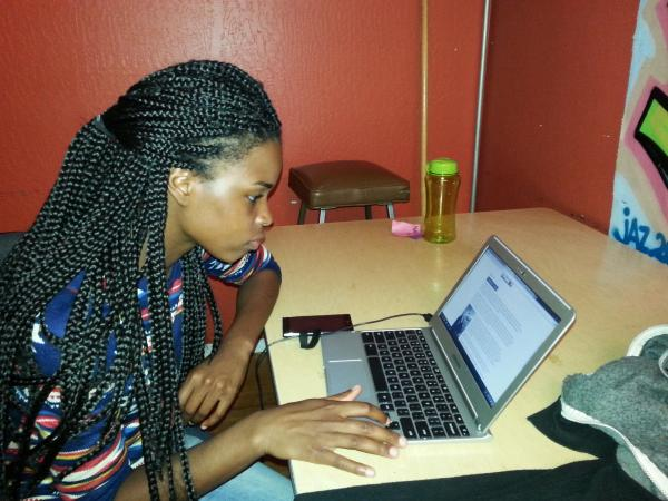 Taneka Armstrong, 20, is learning about different aspects of the tech industry — from coding to sales — through the nonprofit group Hack the Hood.