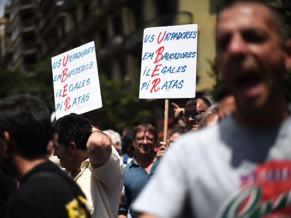 Spanish law does not currently prohibit Uber and other private taxi apps or ride-sharing schemes. But Spain's taxi unions are lobbying politicians to intervene and protect their industry. Here, another scene from the July 1 protests.