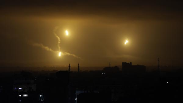 Flares light up the night sky over Gaza City early Friday, Aug. 1. Leaders of Hamas and Israel have agreed to begin a cease-fire Friday at 8 a.m. local time, the U.N. says.