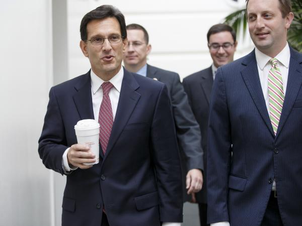 Rep. Eric Cantor of Virginia (left), pictured Tuesday, relinquished his House majority leader post on Thursday and said Friday that he would resign from Congress before the end of his term.
