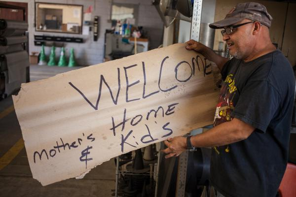 "Arturo Contreras at the CDR Strainers & Filters Inc.. Mr. Contreras made a sign that read ""Welcome Home Mother's & Kids"" to make a statement with his friends at work."