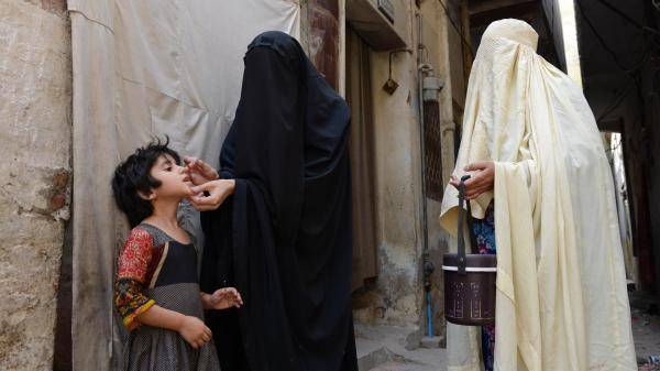 A health worker vaccinates a child during a polio campaign in Bannu, Pakistan, June 25. The Taliban threaten to kill vaccinators and parents who immunize their kids.