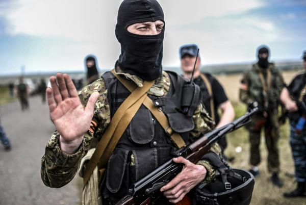 Pro-Russian separatists block the way to the crash site of Malaysia Airlines Flight MH17.