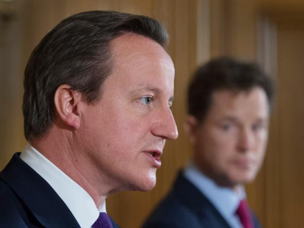 "A letter from British Prime Minister David Cameron (left) states that ""the Government has not banned prisoners' access to books."""
