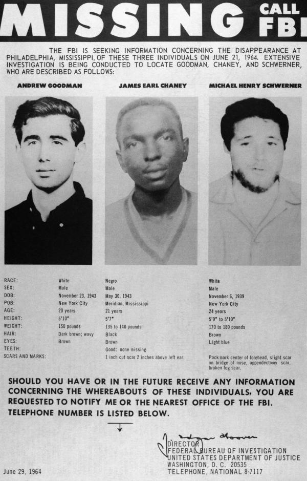 A missing persons poster shows the photographs of civil rights workers Andrew Goodman, James Earl Chaney and Michael Henry Schwerner after they disappeared in Mississippi in 1964. It was later discovered that they were murdered by the Ku Klux Klan, who also targeted blacks who were not activists.