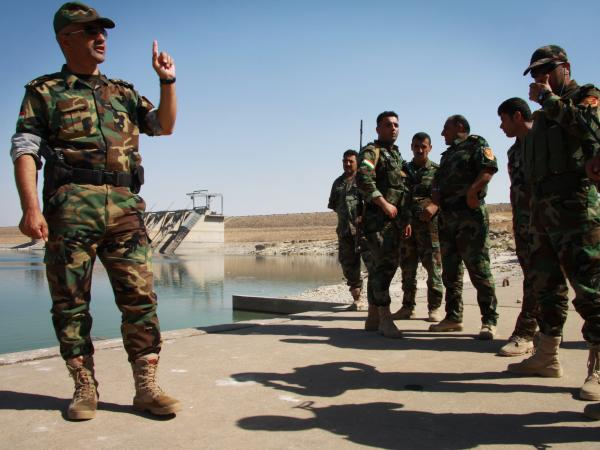 Brig. Gen. Mohammad Ali Mughdeed talks to the men he commands to protect the Mosul dam, a critical piece of infrastructure that supplies water and electricity. The dam recently fell to the Islamic State in Iraq, but Kurdish forces say they've retaken it, a claim that could not be verified.